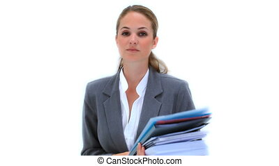 Serious woman holding files against a white background