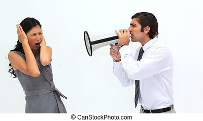 Man shouting into a megaphone against a white background
