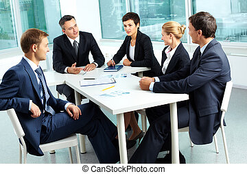 Debating - Image of confident colleagues looking at their...
