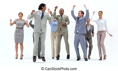 Smiling business people jumping against a white background