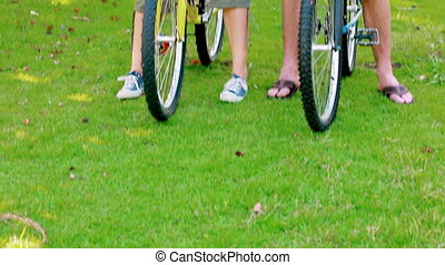 Couple on bikes in a park
