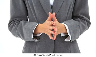 Hands being crossed against a white background