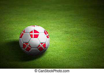 Flag of Denmark with soccer ball over grass background - Euro 2012 championship