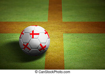 Flag of England with soccer ball over grass background - Euro 2012 championship