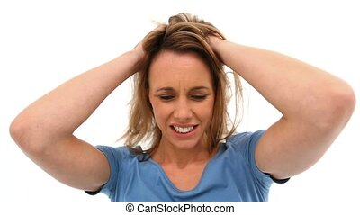 Woman tearing her hair against white background