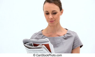 Businesswoman reading a newspaper against white background