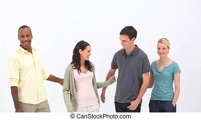 Young people standing together against a white background