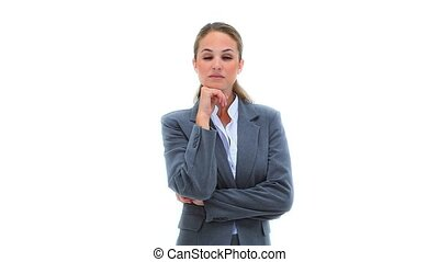 Blonde businesswoman leaning on her fist against white...