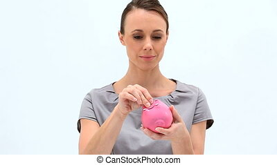 Businesswoman holding an empty piggy-bank against white...