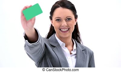 Brunette businesswoman showing a business card against white...