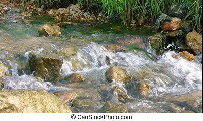 .water runs on stone