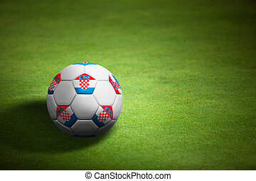 Flag of Croatia with soccer ball over grass background - Euro 2012 championship