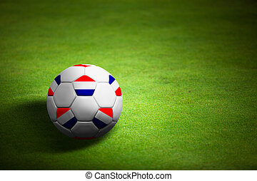 Flag of Netherland with soccer ball over grass background - Euro 2012 championship