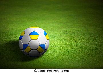 Flag of Ukrains with soccer ball over grass background - Euro 2012 championship