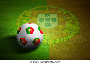Flag of Portugal with soccer ball over grass background -...