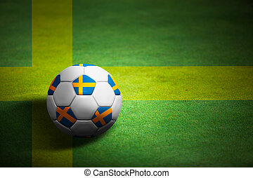 Flag of Sweden with soccer ball over grass background - Euro 2012 championship