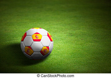 Flag of Spain with soccer ball over grass background - Euro 2012 championship