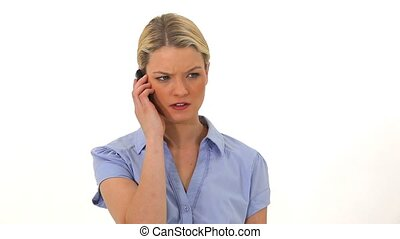 Upset blonde woman on the phone against white background