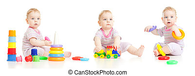 Cute little boy playing colorful toys isolated on white