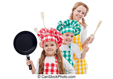 Happy chefs family standing in row holding cooking utensils...