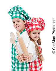 Happy chef kids with wooden cooking utensils - Happy chef...