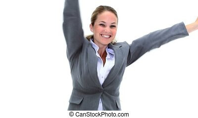 Businesswoman raising her arms against a white background