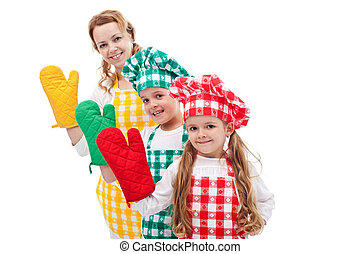 Happy chefs waving with oven gloves - Happy chefs family...
