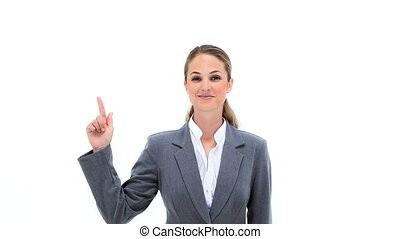 Blonde businesswoman pointing her fingers up against white...