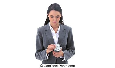Businesswoman counting banknotes against white background
