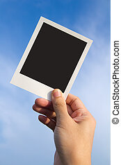 Polaroid photo frames - Hand holds a polaroid photo frame...