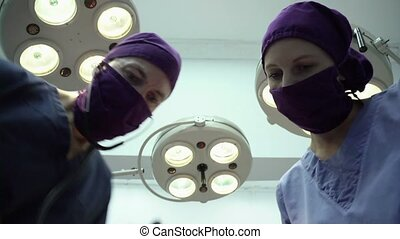 Operation room in clinic, doctors - Teamwork with nurse and...