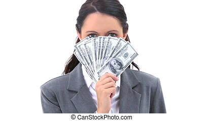 Businesswoman with US banknotes in her hand