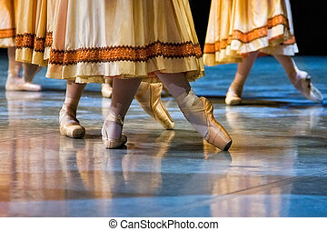 ballet dancers in slippers on the stage