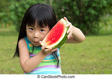 Happy child with watermelon - Little Asian kid with a piece...