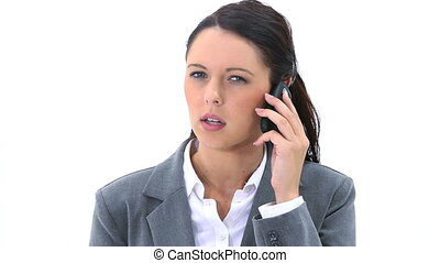 Serious woman speaking on her mobile phone