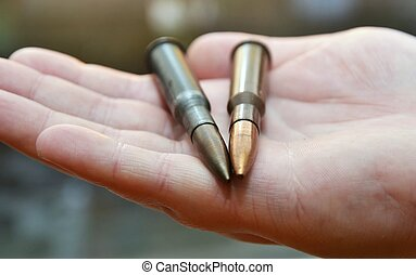 Hands of bullets - Mix of bullets in hand, military...