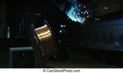 Man working as welder in industry