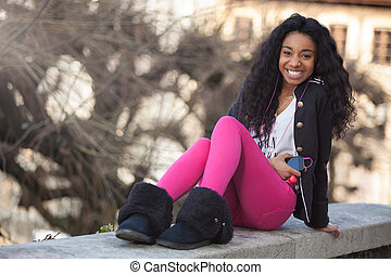 Outdoor of a portrait happy young african american teenage...