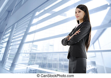 Business vision - Mixed race Asian woman standing on office...
