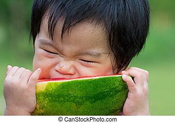 Baby eating watermelon - Little Asian baby eating watermelon...