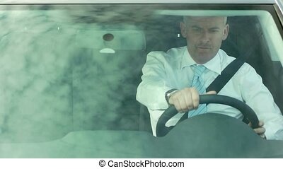 Businessman driving car with belt