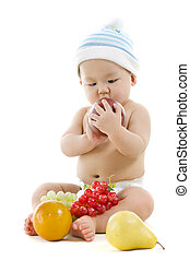 Fruity baby - Pan Asian baby playing with fruits on white...