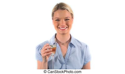 Blonde woman drinking white wine against a white background