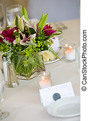 Wedding centerpiece on a table set for fine dining. Shallow...
