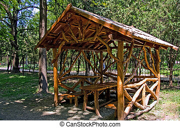 wooden bower - table and bench in wooden bower