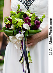 bridal wedding bouquet - a close up of a brides wedding...
