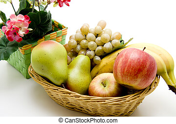 Fruit basket with flowers on white background