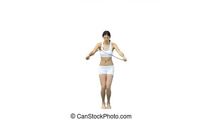 Brunette woman skipping in slow motion against a white...