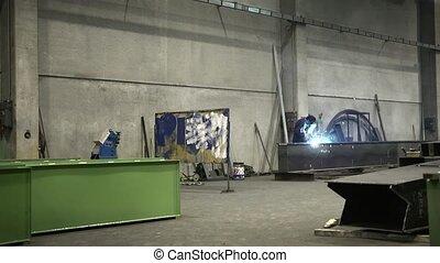 Man at work as welder in factory - Manual worker in steel...
