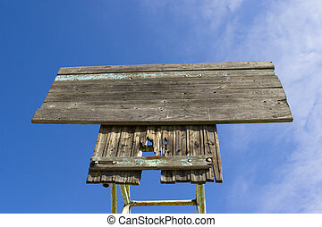 Board on a blue sky background